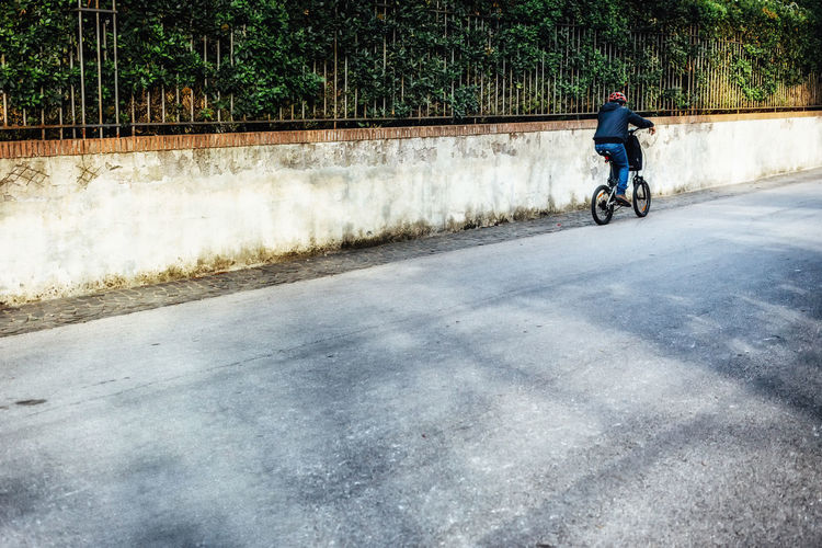 Moving Around Rome Stories From The City Villa Borghese Park Bicycle Biker Cycling Cycling Helmet Leisure Activity Lifestyles Mode Of Transport Motion Nature One Person Outdoors Park Real People Riding Streetphotography Transportation Travel Destinations Villa Borghese