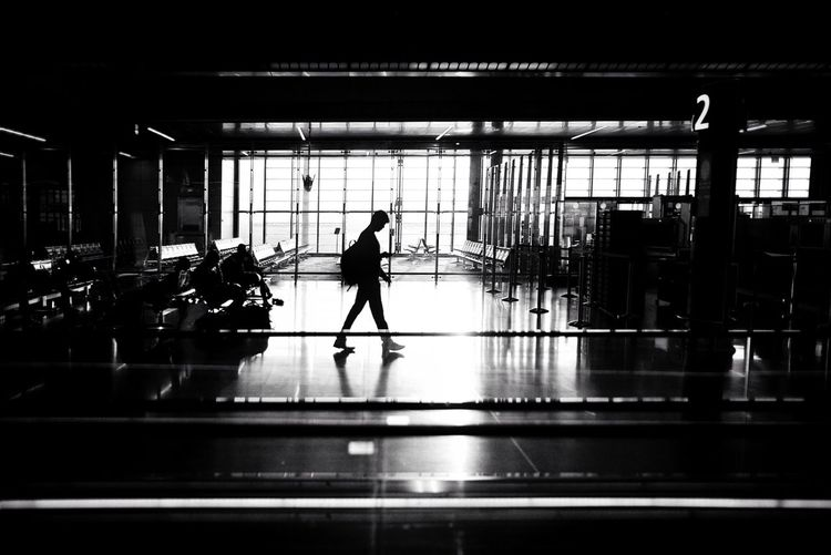 In the searching for light. Lightandshadow Transit Airport Real People Indoors  One Person Transportation