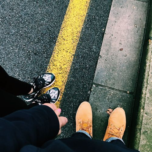 Low Section Human Leg Shoe Human Body Part Yellow Standing High Angle View Real People Men Transportation Day Outdoors Adults Only One Person Adult Only Men People Canvas Shoe