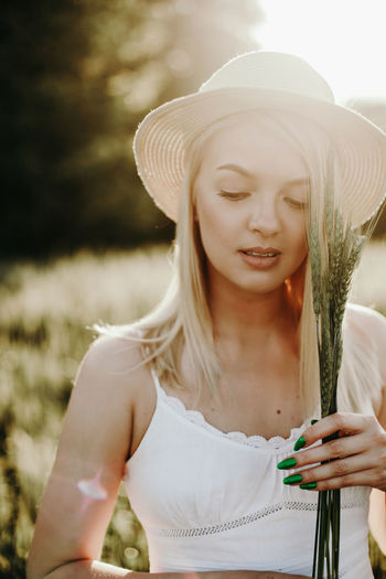 Young woman wearing hat on field