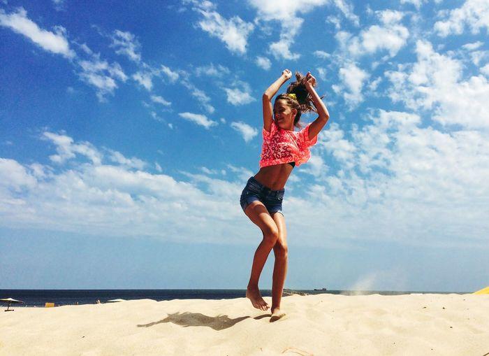 Woman jumping on beach