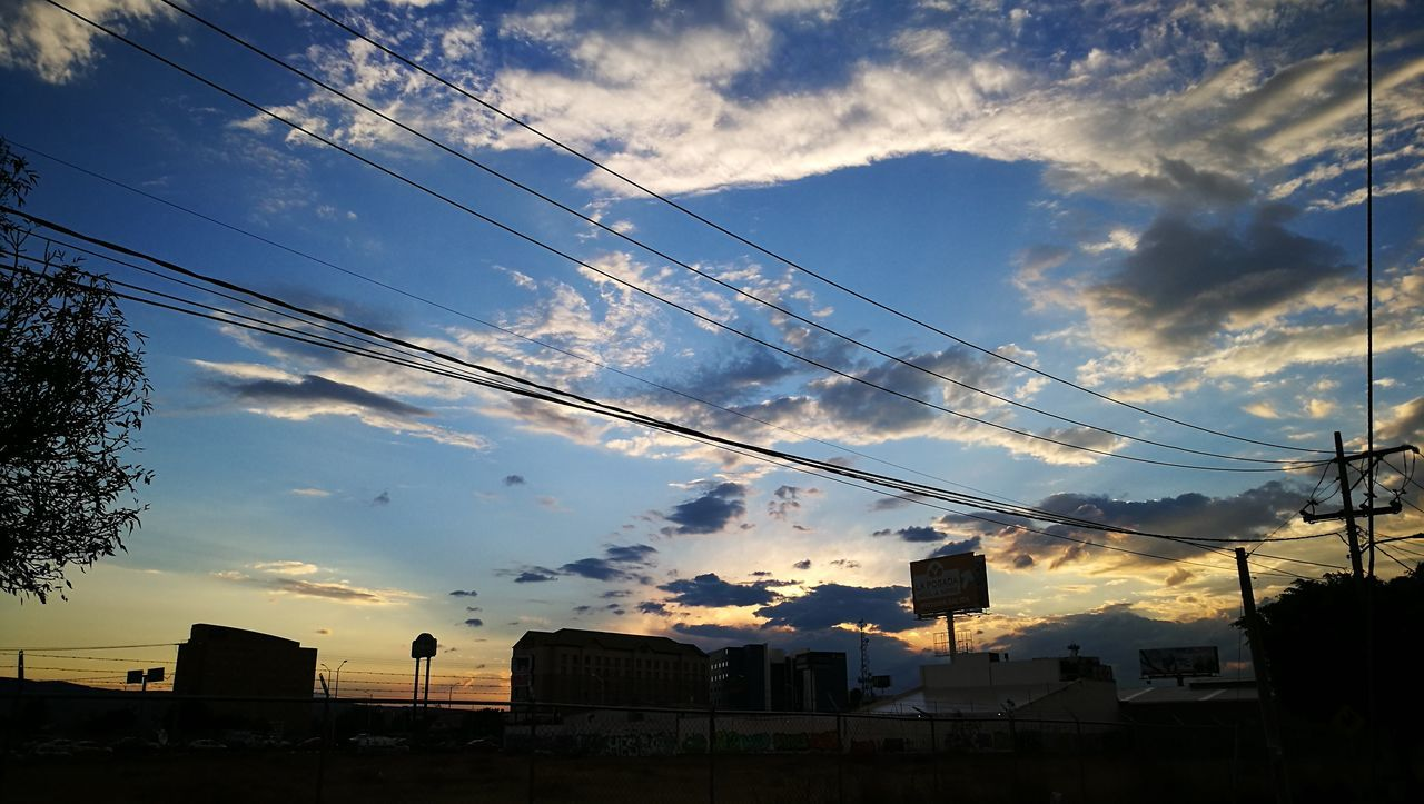 cable, sky, cloud - sky, power line, built structure, power supply, building exterior, low angle view, connection, no people, electricity, sunset, outdoors, architecture, silhouette, electricity pylon, technology, nature, telephone line, day, tree