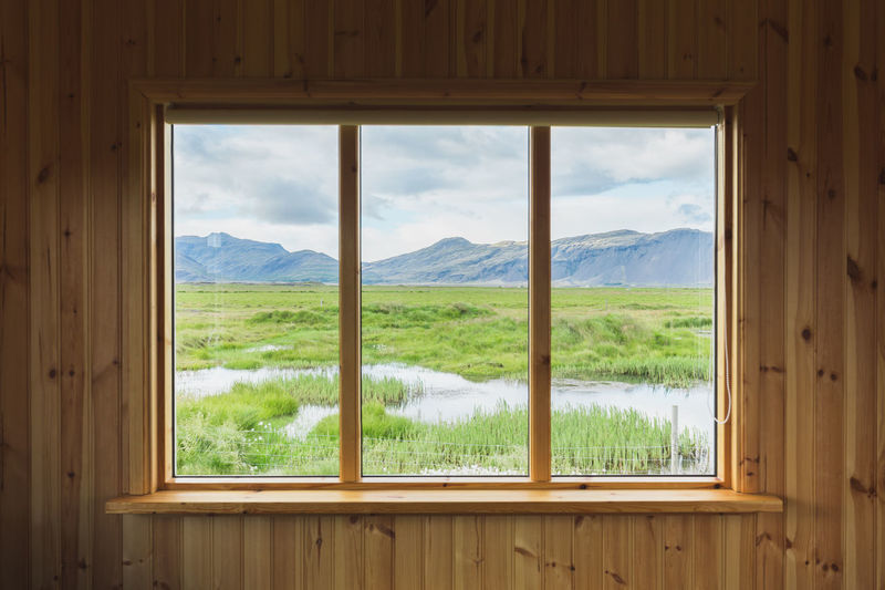 What a view Window Glass - Material Outside Outdoors Landscape Spectacle Nature No People Sky Tranquil Scene Grass Land Indoors