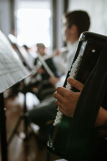 Akkordeon Music Musical Instrument Musician Musical Equipment Sheet Music Incidental People Sitting Artist Playing Indoors  Arts Culture And Entertainment Sheet One Person Performance Paper Holding Real People Concentration Education School Skill  Close-up