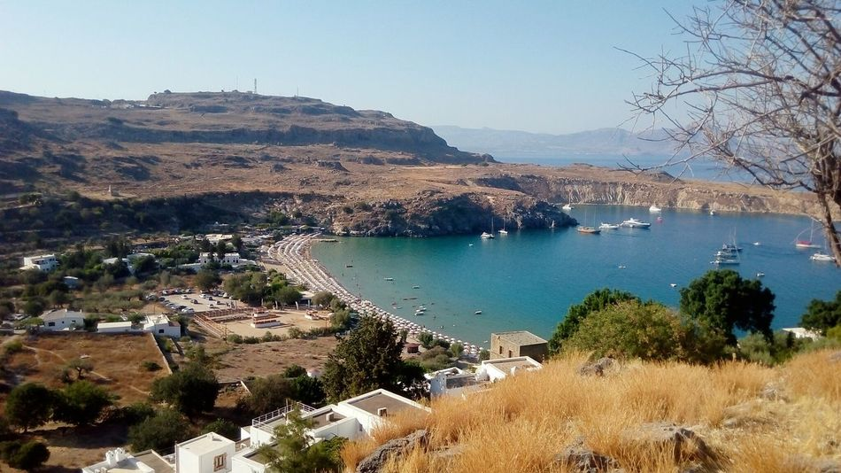 GREECE ♥♥ Bay Tranquil Scene Horizon Over Water Greece Sky High Angle View Outdoors Day Beach Tranquility Nature Beach Photography Vacations Nautical Vessel Cloud - Sky Sun Light Tree Bird Sun Island Rhodes Lindos Castle Village View EyeEmNewHere Investing In Quality Of Life The Week On EyeEm Your Ticket To Europe The Traveler - 2018 EyeEm Awards 10
