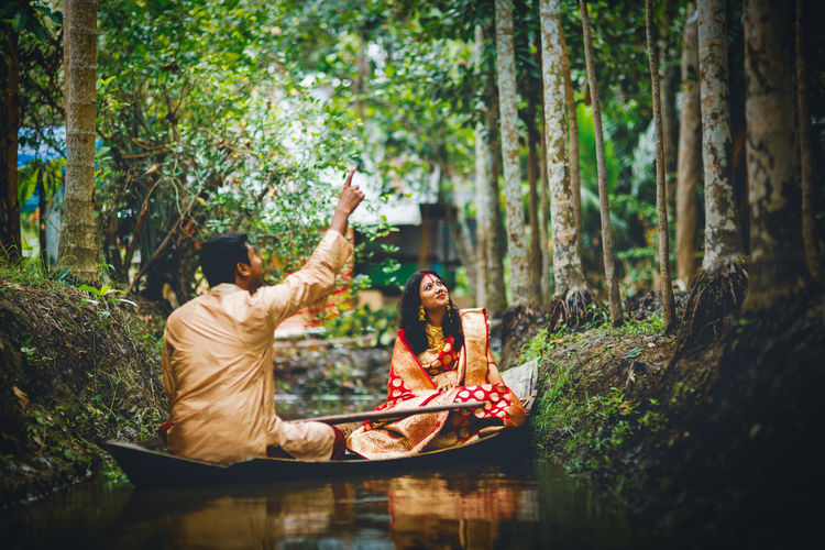 Couple in a boat at clear water canal