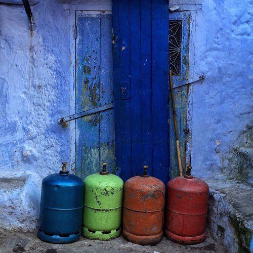Gas cylinders against old wooden door