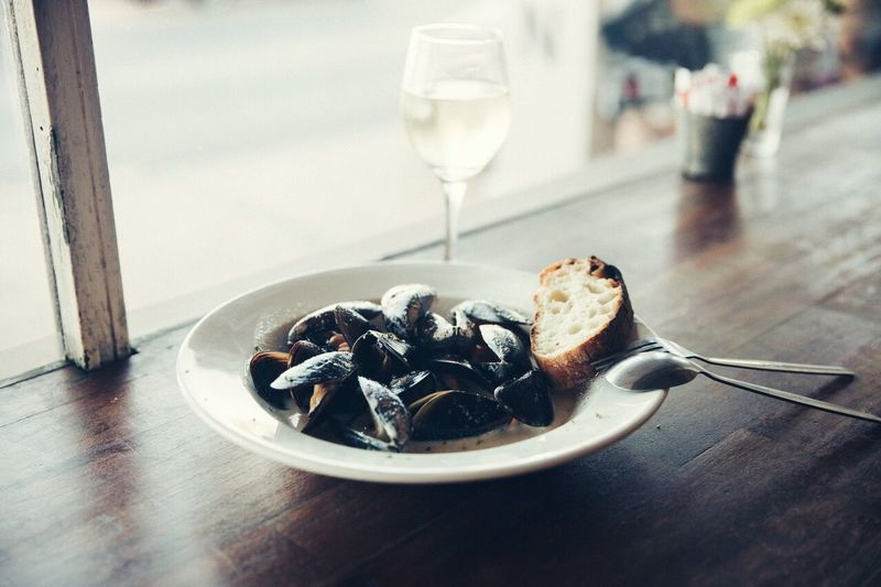 EyeEm Selects Food And Drink Table Drink Indoors  Plate Food Indulgence No People Fork Close-up Ready-to-eat Focus On Foreground Serving Size Alcohol Leftovers Dessert Freshness Day Sweet Food Wineglass Mussels