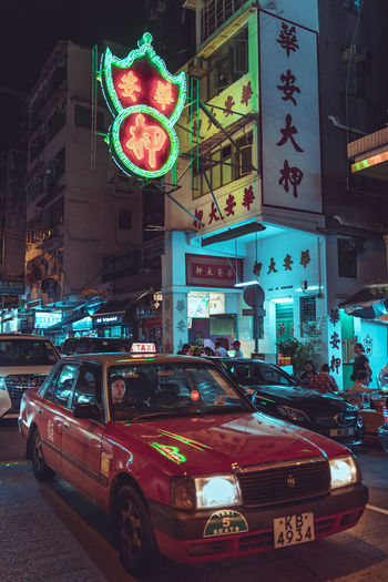 Taxi Taxi Driver Neon Neon Lights Neon Sign Pawn Shop Old Buildings Kowloon City EyeEm Best Shots EyeEm Selects EyeEm Gallery Motor Vehicle Car City Mode Of Transportation Architecture Building Exterior Street Night Land Vehicle Transportation Built Structure Illuminated City Street Sign City Life Road Building Communication Incidental People Traffic Outdoors