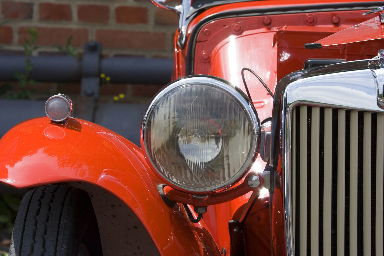 headlight, transportation, mode of transport, land vehicle, red, car, outdoors, day, no people, close-up