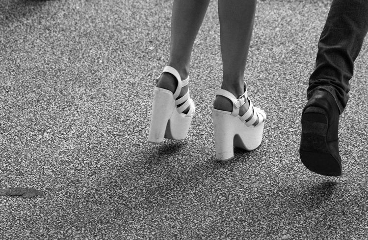 White Shoes Low Section Human Leg Human Body Part Standing Day Real People Outdoors Lifestyles One Person Close-up People Adult White Shoes Black Shoes Walking Legs And Feet Man's Shoes Woman's Shoes High Heels White High Heels Going Out Two Shoes EyeEmNewHere Streetphoto_bw Street Photography