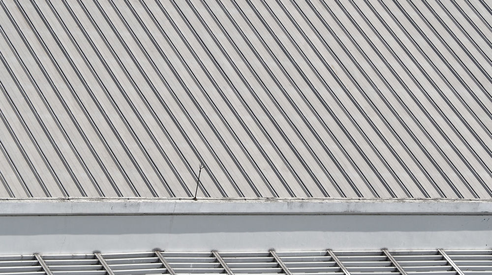 Dirty old metal texture roof of building and top view. Day Material Metal No People Outdoors Roof Top Roof; Metal; Roofing; Building; Commercial; Corrugated; Industrial; Warehouse; Steel; Construction; Sheet; White; Iron; Industry; Zinc; Pattern; Galvanized; Background; Perspective; Texture; Aerial; Panel; Aluminum; Coating; Shiny; Gray; Grey; Material; S Top View