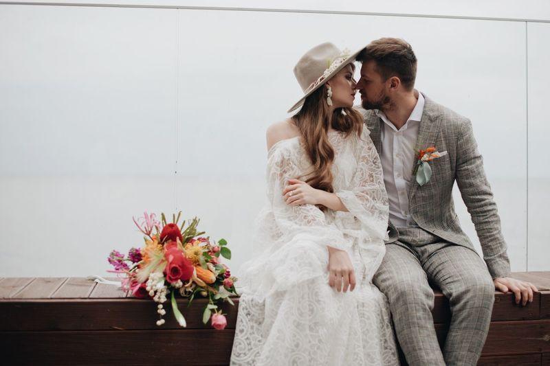Bride and bridegroom sitting on seat