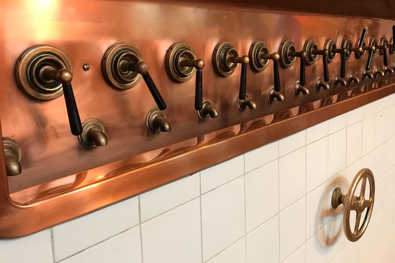 Knobs and faucets on wall