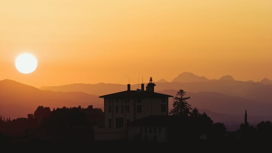 Silhouette building against sky during sunset