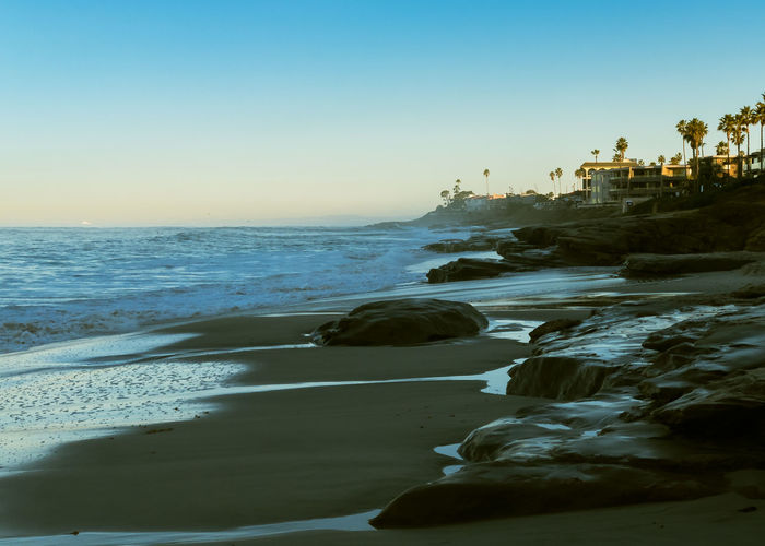 Coastline Dawn Beach Early Mornings Horizon Over Water No People Reflective Rock - Object Sand Travel Destinations Vacations
