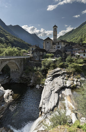 Lavetezzo is a Swiss commune in the canton of Ticino, located in the district of Locarno, district of Verzasca. Built Structure Architecture Water Sky Building Exterior Mountain Nature Plant Tree No People Day Building Bridge Bridge - Man Made Structure River Cloud - Sky Rock Connection Outdoors Arch Bridge Lavertezzo Switzerland Alps Switzerland Tesino Locarno, Switzerland