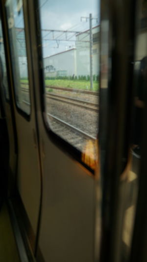 Train seen through glass window