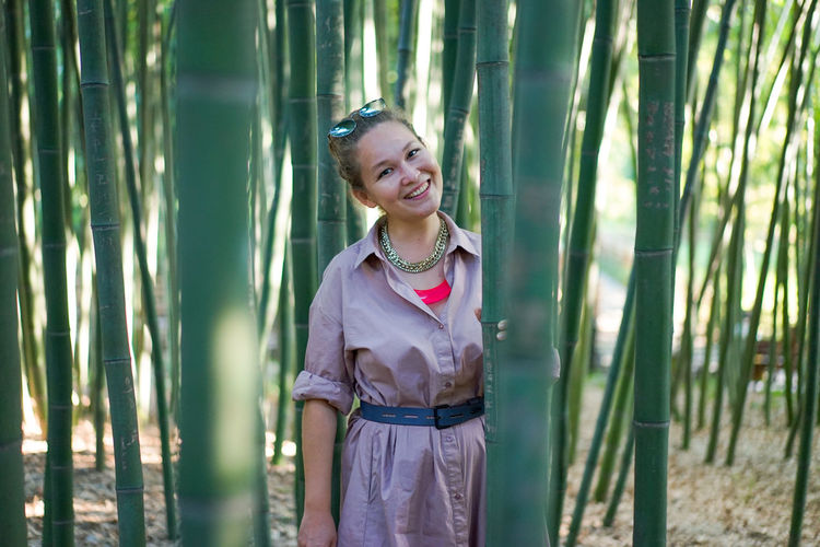 A young woman in a bamboo grove