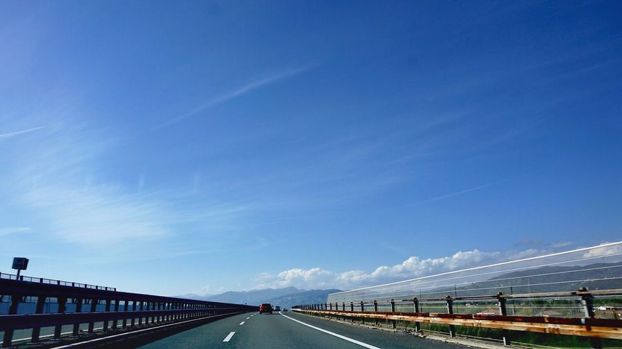 Transportation Road The Way Forward Blue Railing Day Sky Outdoors No People Nature Drive Driving On The Road Travel Versilia  Italy Tuscany Blue Sky Asphalt Road Roadtrip Visit Voyage Road Sign The Architect - 2017 EyeEm Awards