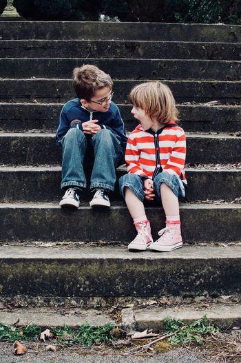 Boy sitting on steps