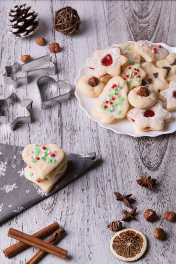 Christmas cookie Christmas Cookies Cookies Nuts Ready To Eat Sugar Bakery Bakeware Christmas Decoration Cinnamon Close-up Crumble Mixture Food Food Photography Food Still Life Fresh Marmelade No People Nut Sweet Table White Background