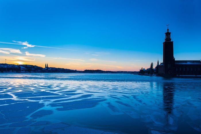 Architecture Built Structure Building Exterior Water Blue Reflection Tower Cold Temperature Sky Tranquil Scene Scenics Travel Destinations Waterfront Tranquility Nature Outdoors Tourism Cloud - Sky Stockholm, Sweden Tourist Attraction  Nobel Prize