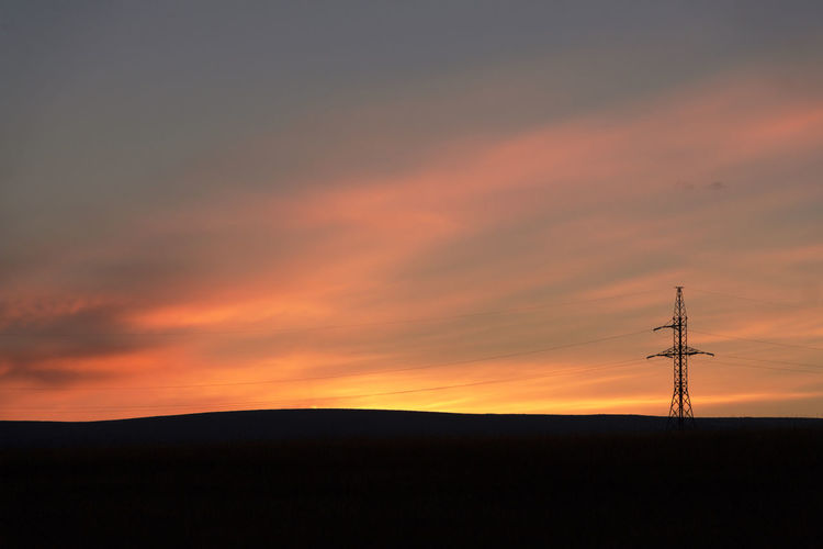 Sunset over electricity pylon Paint The Town Yellow Beauty In Nature Cloud - Sky Connection Day Electricity  Electricity Pylon Field Landscape Nature No People Orange Color Outdoors Scenics Silhouette Sky Sunset Technology Tranquil Scene Tranquility