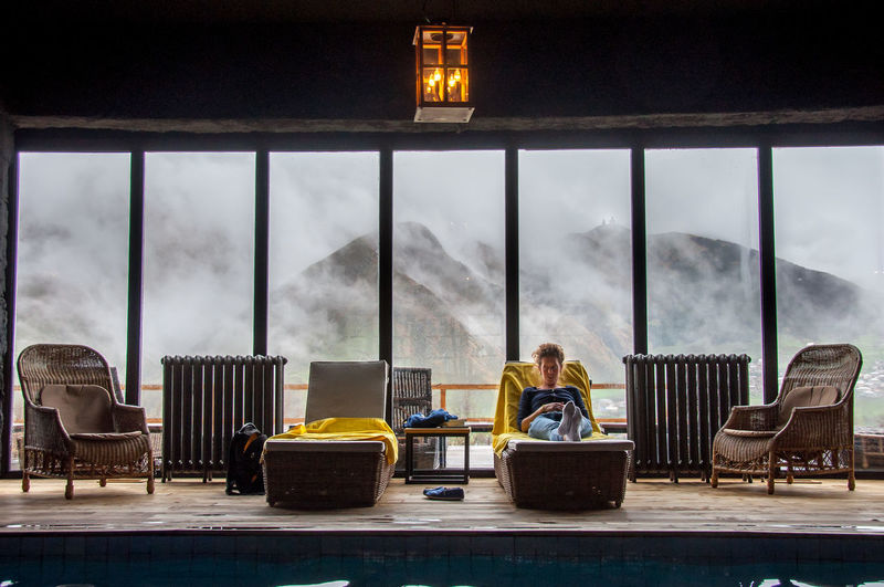 shoot in kazbegi, georgia Blanket Chair Fog Foggy Foggy Day Foggy Morning Girl Holiday Hotel Lamp Mountain Mountain View Mountains Relax Relaxation Relaxing Roomshotelkazbegi Swim Swimming Pool Travel Travel Photography Traveling Vacation Woman Yellow
