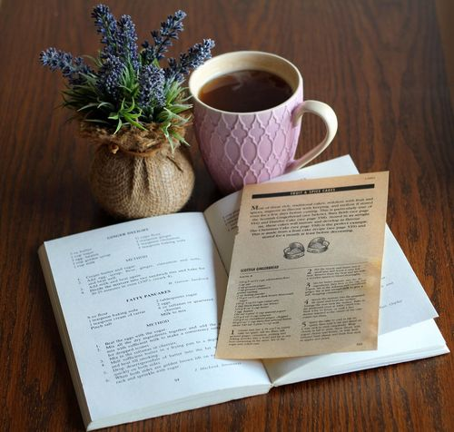Hot tea and an old recipe book. Book Cozy Drink Food And Drink Indoors  Old Book Recipe Table Tea Tea Mug Teatime Wood - Material