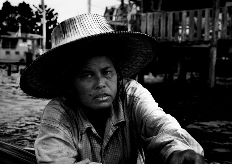 Boat Trader at Chao Phraya River Hat One Person Real People Portrait Headshot Focus On Foreground Young Adult Contemplation Outdoors Adult Trading River Water Boat Woman Senior Adult Asian  Thailand