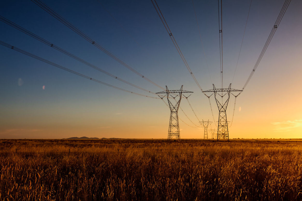 Beauty In Nature Cable Clear Sky Connection Day Dusk Electricity  Electricity Pylon Field Fuel And Power Generation Grass Landscape Nature No People Outdoors Power Line  Power Supply Rural Scene Scenics Sky Sunset Tranquil Scene Tranquility
