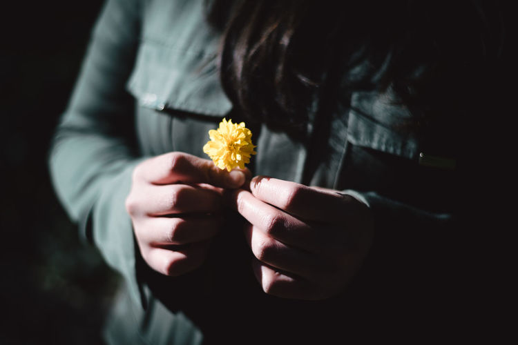 Saying goodbye Close-up Darkness And Light Day Detail Flower Flower Head Focus On Foreground Fragility Freshness Goodbye Green Holding Human Hand Indoors  Midsection One Person People Real People Water Woman