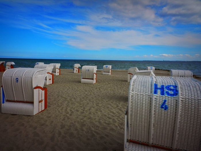 Baltic Sea Beach Beauty In Nature Blue Chair Cloud - Sky Germany Holiday Hooded Beach Chair Horizon Horizon Over Water Land Nature No People Number Outdoors Sand Scenics - Nature Sea Sky Tranquil Scene Tranquility Water