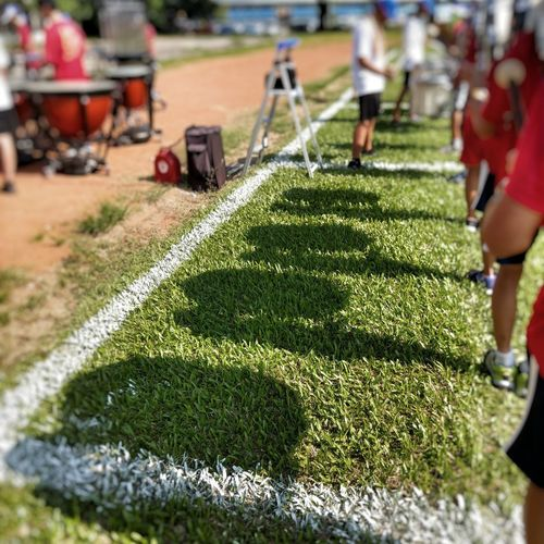 Grass Incidental People Green Color Field Day Outdoors Sunlight Real People Men Nature People Adult Drum - Percussion Instrument Drum Corps Marching Band