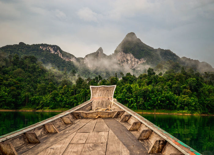Khao Sok National Park National Park Thailand Beauty In Nature Boat Cloud - Sky Day Lake Longtail Boat Mountain Mountain Range Nature No People Non-urban Scene Outdoors Plant Power In Nature Reflection Scenics - Nature Sky Tranquil Scene Tranquility Travel Destinations Tree Water