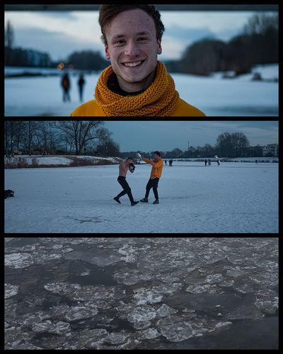 Full length of smiling man in lake during winter