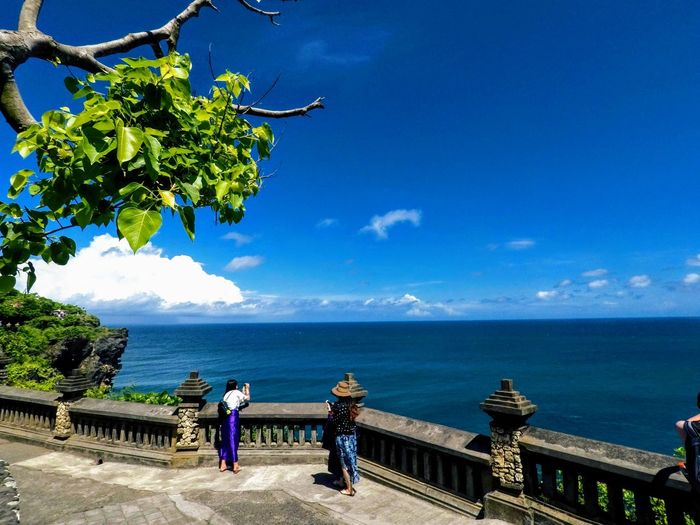 Bali Ancient Group Of People People Taking Photos Traveler Tourism Tree Water Sea Full Length Standing Women Blue Sky Horizon Over Water Architecture Friend Historic Seascape Tide Rocky Coastline Ocean Surf Wave Visiting Observation Point Looking At View Groyne Coastline