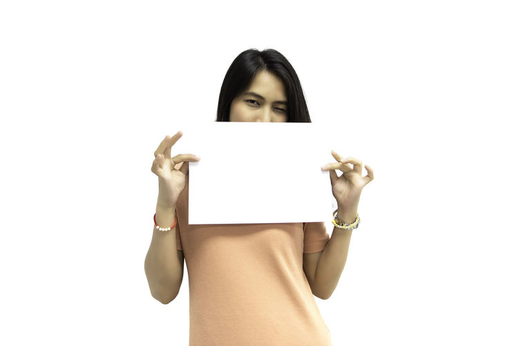 Portrait of woman standing against white background