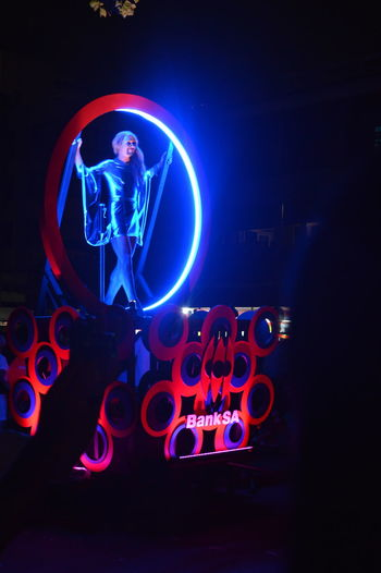 Arts Culture And Entertainment Car City City Life City Street Communication Dark Electric Light Event Festival Glowing Illuminated Land Vehicle Light Light - Natural Phenomenon Lighting Equipment Music Night Pageant Street Street Light Transportation