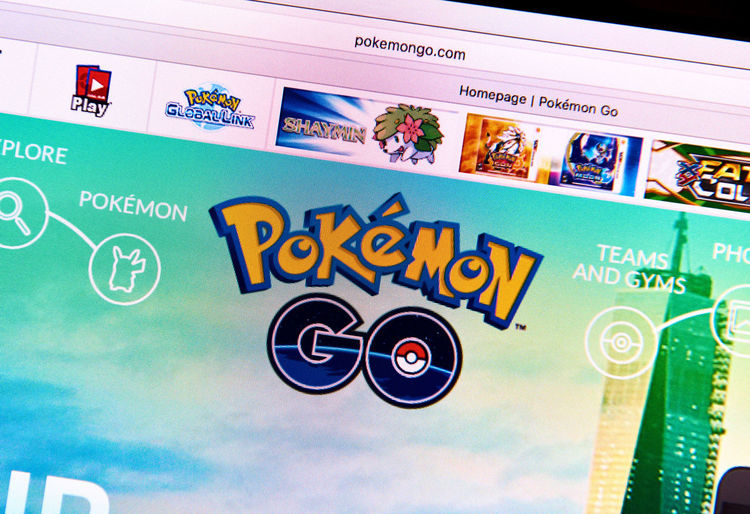 Riga, Latvia- July 17, 2016 : Pokemon Go home page on a monitor screen. Pokemon Go is a popular virtual reality game for mobile devices. The game allows players to capture, battle, and train virtual creatures, called Pokemon, who appear on device screens as though in the real world. Computer Creatures Editorial  Entertainment Game Gaming Google Home Page Icon Illustrative Interface Logo Media Monitor Play Pokemon Go Popular Reality Screen Screenshot Sign Technology Virtual Website Www