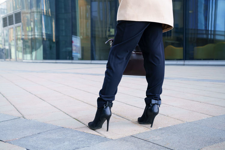 A business woman walks to the business center in heels. conceptual horizontal photo without a face