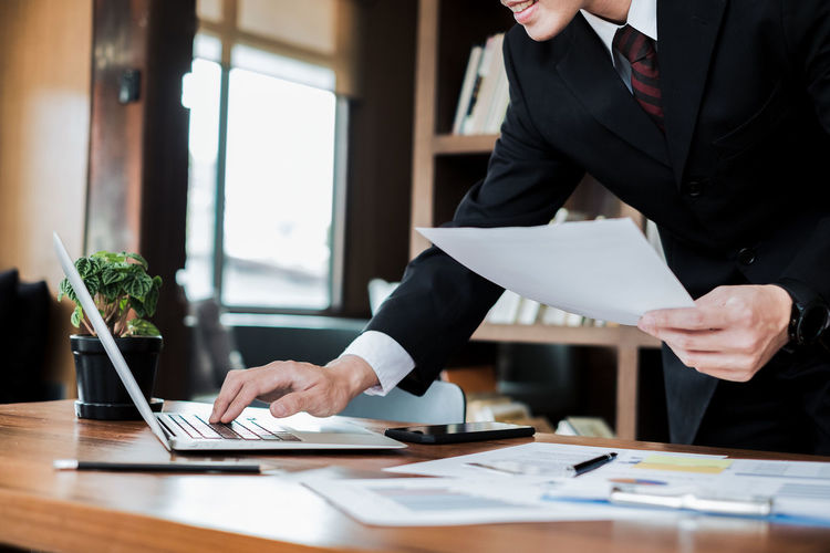 Close-Up Of Businessman Working In Office