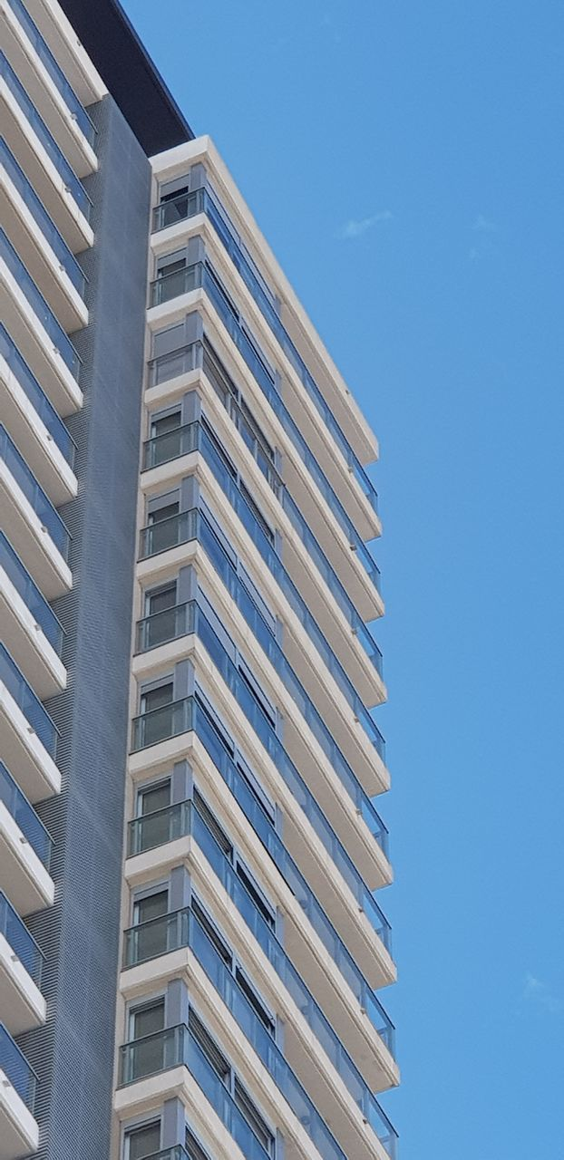 architecture, building exterior, built structure, building, sky, low angle view, city, nature, no people, window, day, sunlight, modern, blue, outdoors, residential district, clear sky, apartment, tall - high, pattern, office building exterior