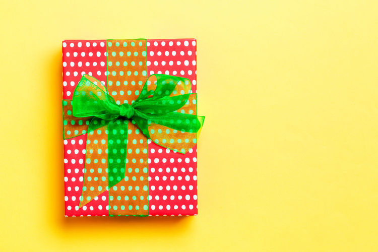 Close-up of green box against yellow background