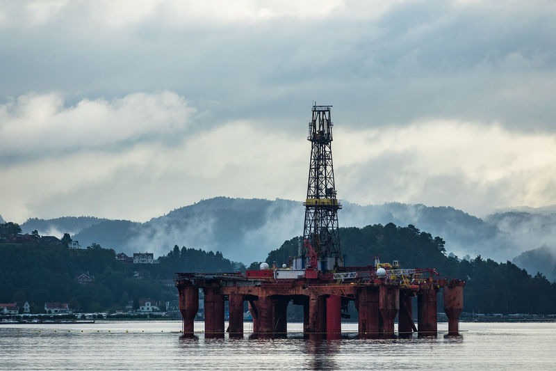 Drilling rig on the Lyngdalsfjord in Norway. Lyngdal Norway Relaxing Scandinavia Sky And Clouds Travel Cloud - Sky Coast Day Drilling Rig Fjord Journey Lyngdalsfjord Nature No People North Oil Platform Oil Rig Outdoors Shore Sky Tourism Travel Destinations Vacation Water