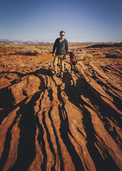 Full length of man on rock against sky