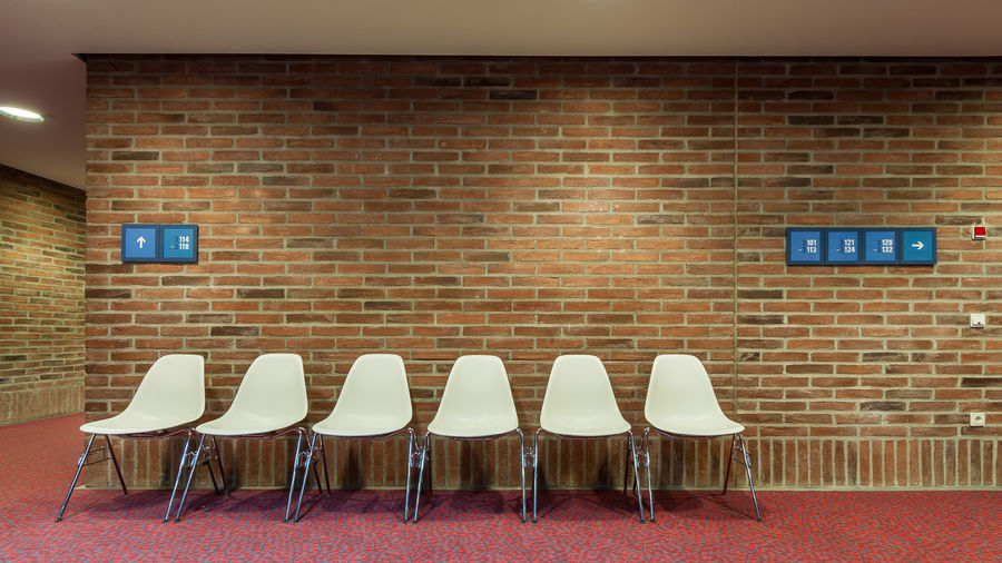 Chairs in brick wall