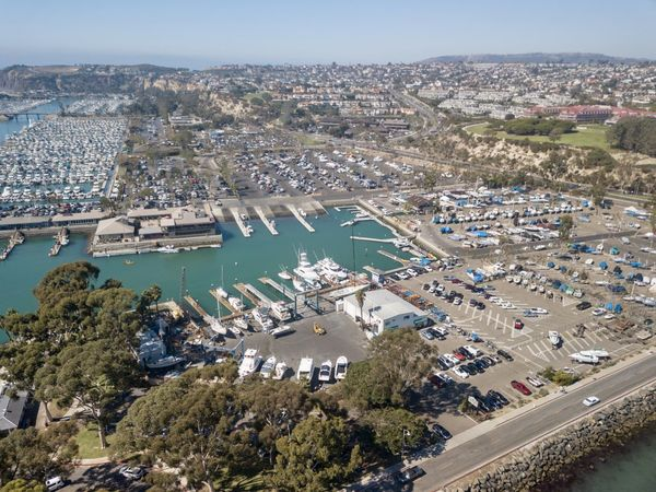 aerial view of Dana Point Harbor in Orange County California Dana Point, Ca Dana Point Harbor Harbor Boats Aerial View Drone View Architecture Water Building Exterior City High Angle View Cityscape Nature Day Outdoors Pacific Ocean Seascape