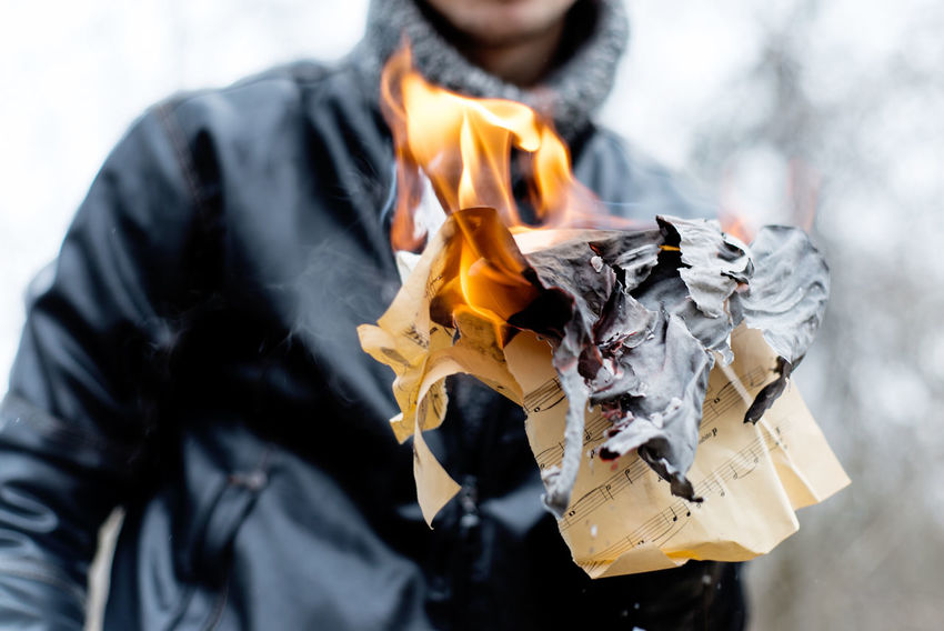 Destruction Hands Music Youth Bonfire Boy Burning Day Fire Fire - Natural Phenomenon Fire Pit Flame Holding Hooliganism Human Hand Lifestyles Men Musician Notes Outdoors Real People Teen Teenager Vandalism Young Adult